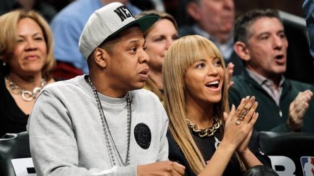 Entertainer and Brooklyn Nets minority owner Jay-Z and his wife, entertainer Beyonce, right, taking in a Brooklyn Nets game in November.