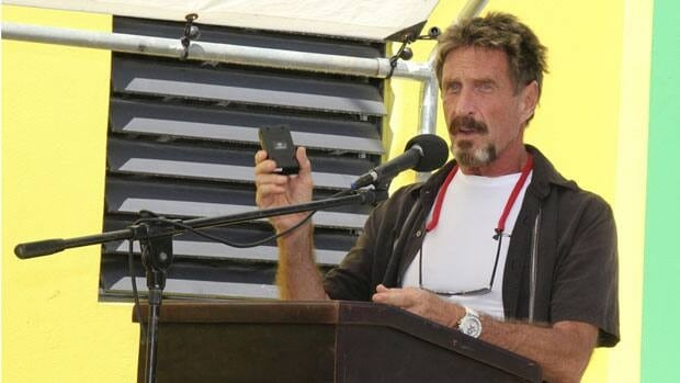 John McAfee, shown here in November making a presentation in Ambergris Caye, Belize, has been identified as a person of interest in the killing of his neighbor, 52-year-old Gregory Faull.