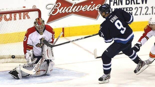 Evander Kane of the Winnipeg Jets scores a goal against Jose Theodore of the Florida Panthers.