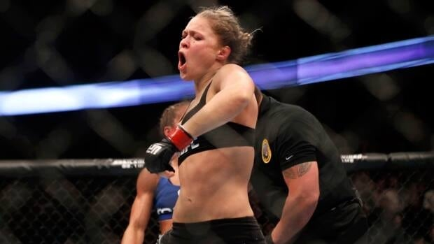 Ronda Rousey celebrates after defeating Liz Carmouche after their women's bantamweight championship mixed martial arts match in Anaheim, Calif. on Saturday.