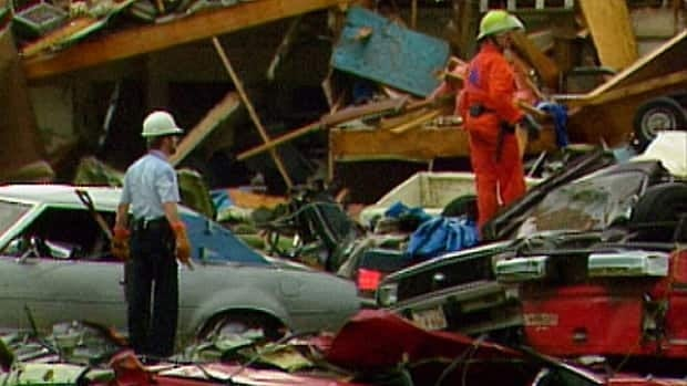 Searchers look for bodies in the carnage left behind from the Edmonton Tornado, July 31, 1987.