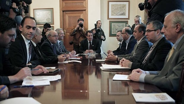 Cyprus' President Nicos Anastasiades center, met with party leaders and the governor of the Central Bank of Cyprus Panicos Demetriades, second right, at the Presidential Palace, looking for an alternative bailout plan.