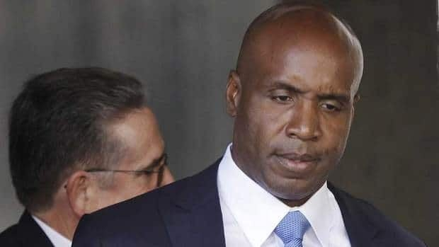 In this June 23, 2011 file photo, former San Francisco Giants baseball player Barry Bonds leaves the federal courthouse in San Francisco after a hearing about his perjury trial. Bonds and his lawyers have been granted a 30-day extension to file written arguments in his appeal of his obstruction of justice charge.