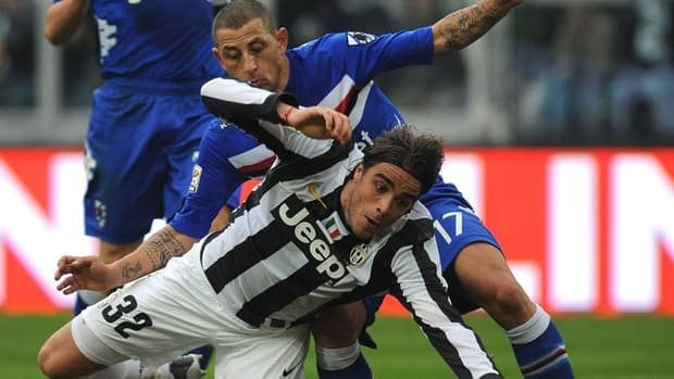 Juventus' Alessandro Matri is tackled by Angelo Palombo of Sampdoria in their match on Sunday.