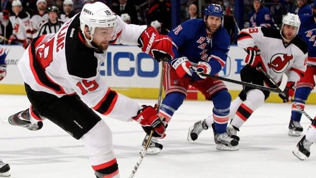 New Jersey Devils forward Travis Zajac scores against the New York Rangers during Game Five of the 2012 Eastern Conference Final in New York, N.Y.