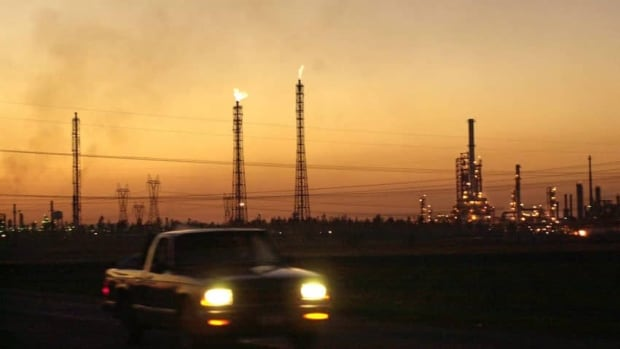 A truck drives past a refinery in Salamanca, Mexico, 280 km northwest of Mexico City. President Enrique Pena Nieto has put forward a daring proposal to revamp energy policy and modernize the state-owned Pemex.