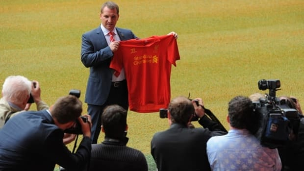 Brendan Rodgers poses for photographers at Anfield in Liverpool, England, on Friday.
