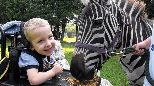 Evan Pennington, 8, suffers from severe spastic quadriplegia cerebral palsy.