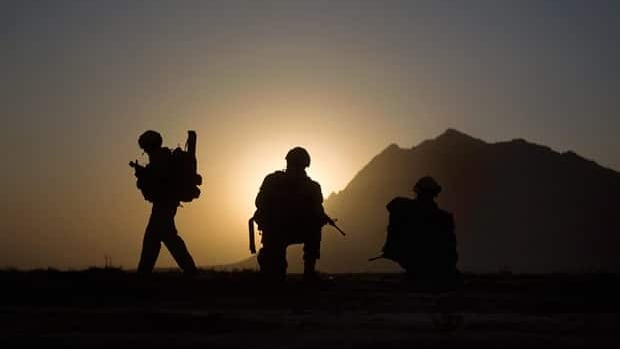 Canadian soldiers with the 1st Battalion 22nd Royal Regiment prepare for an operation in Kandahar in June 2011.