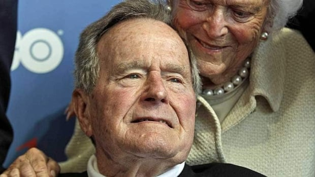 Former U.S. president George H.W. Bush with his wife, Barbara, in June. He is expected to remain in a Houston hospital recovering from bronchitis.