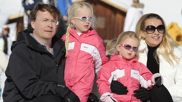 The Netherlands' Prince Friso, left, and his wife Princess Mabel pose with their daughters Luana and Zaria at the Austrian ski resort of Lech. On another ski trip in February 2012, Prince Friso was buried under an avalanche, and the Dutch royal house announced Monday he has died at age 44.