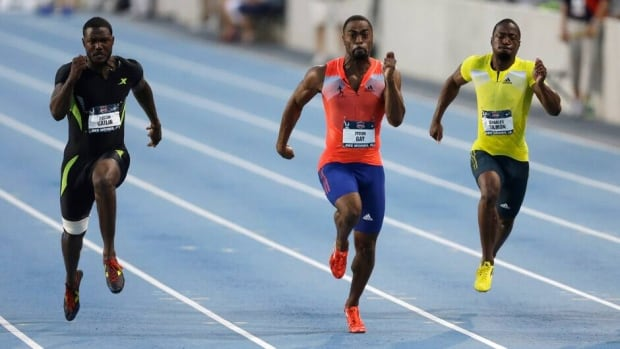 Tyson Gay, centre, leads Justin Gatllin, left, and Charles Silmon during the senior men's 100-metre final at the U.S. Championships on Friday in Des Moines, Iowa.