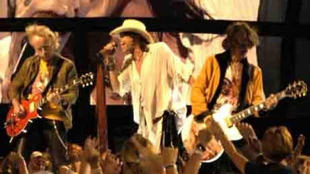 Brad Whitford, Steven Tyler, and Joe Perry of Aerosmith performing in Washington, DC.