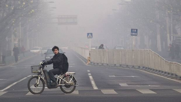Extremely high pollution levels shrouded eastern China for the second time in about two weeks Tuesday, forcing airlines in Beijing to cancel flights because of poor visibility and prompting government warnings for residents to stay indoors.