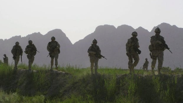 Canadian soldiers patrol an area in the Dand district of southern Afghanistan in 2009. Military ombudsman Pierre Daigle said the need for mental health services will continue long after the draw-down from Afghanistan.