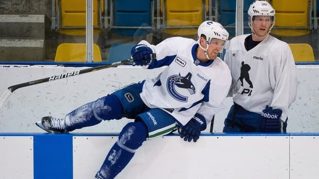If all goes as well and the players ratify the new CBA, Vancouver Canucks forwards Henrik Sedin, left, and teammate Jannik Hansen will take to the ice when the regular season is expected to begin on Jan. 19.