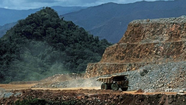 A truck drives along a hill at the Pueblo Viejo mine in the Dominican Republic, a joint venture of Goldcorp and Barrick Gold. Today, Goldcorp reported a $1.93 billion US loss after the writedown of the Penasquito operation in Mexico.