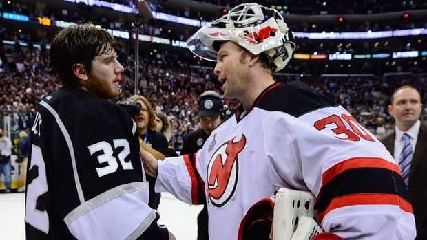 Los Angeles Kings goalie Jonathan Quick, left, is congratulated byg New Jersey Devils goalie Martin Brodeur after the Kings defeated the Devils 6-1 to win the Stanley Cup on Monday.