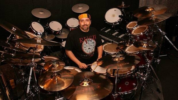 Sam Albidone is a Rush mega-fan, and drums with Wavelength, a Rush tribute band supergroup. He's sitting at his Neil Peart custom DW drumset - which is worth about as much as two new cars.