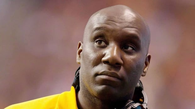Edmonton Eskimos head coach Kavis Reed was a defensive back with the team from 1995 to 1999.