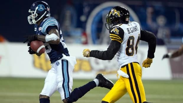 Toronto Argonauts defensive back Pat Watkins, left, intercepted a Hamilton pass in a Sept. 8 game last year.