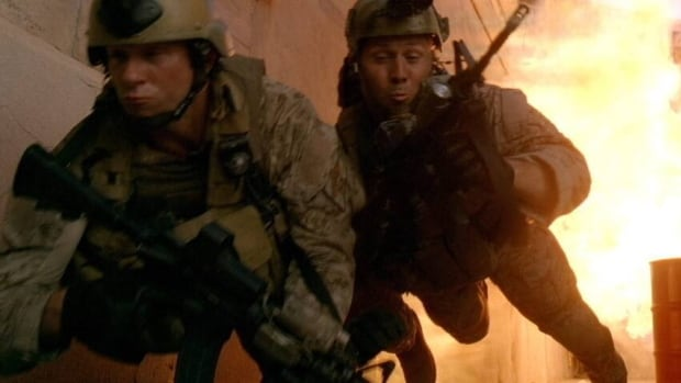 A scene from the film Act of Valor, starring active-duty U.S. Navy SEALs. Commanders allowed a film company into their elite ranks to turn training exercises into a feature-length movie five years ago, in hopes of drumming up recruits. This week several SEAL members were punished for providing classified information to the maker of a video game.