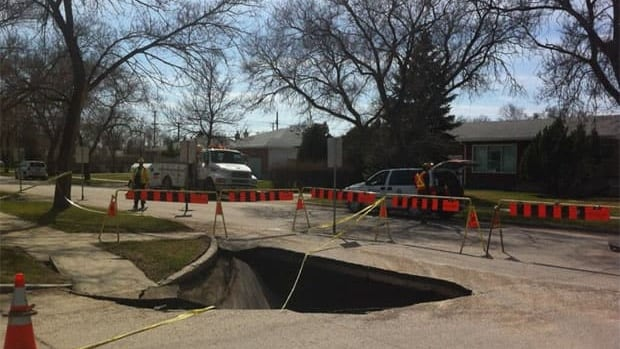 A large sinkhole in Winnipeg's Garden City area has been taped off by police.