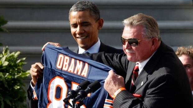 Former Chicago Bears coach and player Mike Ditka, right, seen here with President Barack Obama in Washington, D.C. in October 2011, suffered a minor stroke on Friday.