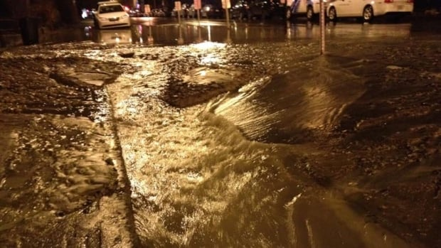 Large piles of mud and rocks spewed out onto the street when the water main broke early this morning, around 2:30 a.m.