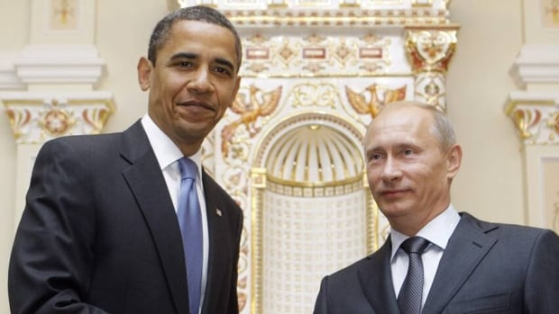 U.S. President Barack Obama shakes hands with then-Russian Prime Minister Vladimir Putin in 2009. Russia banned 18 Americans Saturday from entering the country in response to Washington imposing sanctions on 18 Russians for alleged human rights violations.