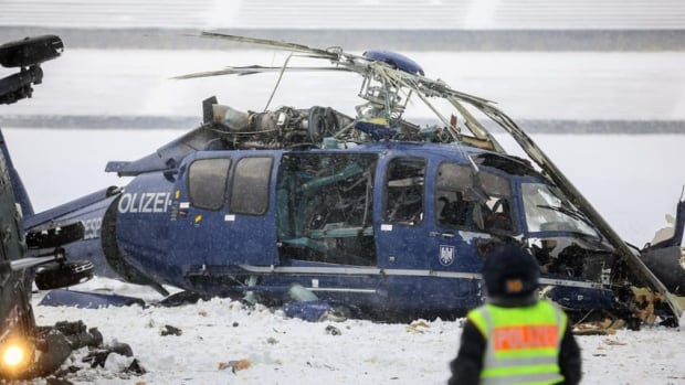 The wreckage of two crashed helicopters of the German federal police lies in a field at the Olympic Stadium in Berlin on Thursday. The two helicopters collided as they approached for landing during a training exercise.