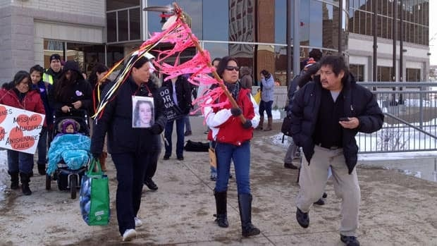 Sharon Johnson (centre) leads the memorial walk for missing and murdered Indigenous women in Thunder Bay. Her sister Sandra was murdered 21 years ago in the city. The case remains unsolved.