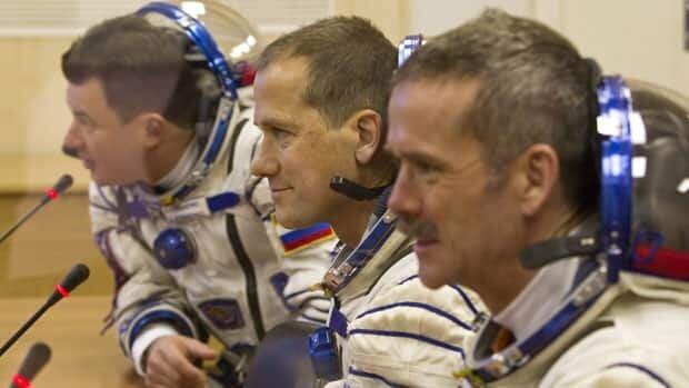 The International Space Station (ISS) crew members, from left: Russian cosmonaut Roman Romanenko, U.S. astronaut Thomas Marshburn and Canadian astronaut Chris Hadfield speak at the Baikonur cosmodrome, Kazakhstan, Dec. 19.