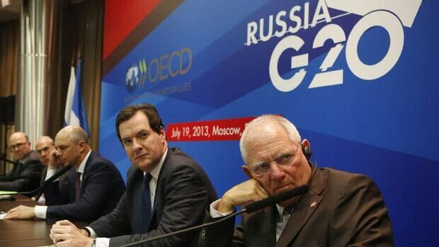 U.K. Chancellor of the Exchequer George Osborne, far right, Russia's finance minister, Anton Siluanov, Angel Gurria, secretary-general of the Organization for Economic Co-operation and Development (OECD), and France's finance minister, Pierre Moscovici, at a news conference at Friday's meeting of G20 finance ministers and central bank governors' meeting in Moscow.