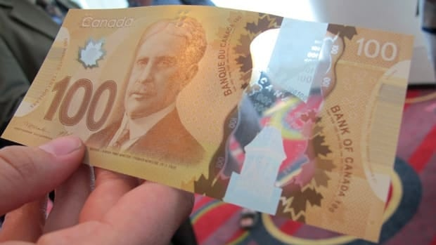 The new $100 bill has a plastic feel and two clear windows. The new currency design was unveiled in Toronto and other cities, June 20.