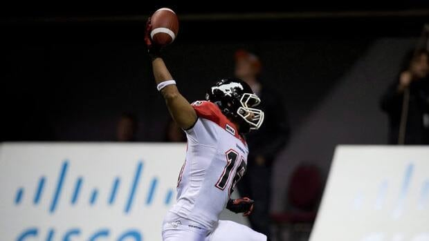 Marquay McDaniel of the Calgary Stampeders spikes the ball after scoring early in the CFL West final in Vancouver.