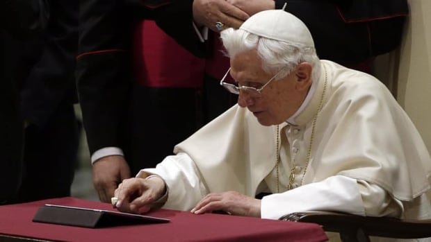 Pope Benedict XVI pushes a button on a tablet at the Vatican on Wednesday to send a tweet from his new personal account.