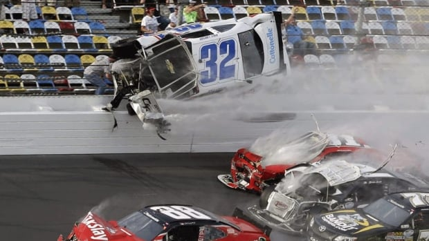 Kyle Larson (32) goes airborne and into the catch fence in a multi-car crash at Daytona International Speedway on Saturday, which injured more than 30 people.