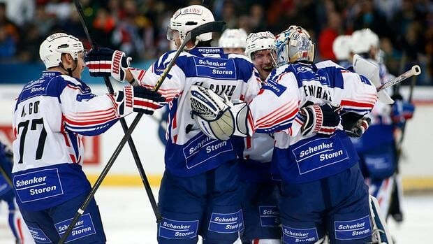 Adler Mannheim players celebrate their victory against Team Canada during the 86th Spengler Cup ice hockey tournament, in Davos, Switzerland on Wednesday.