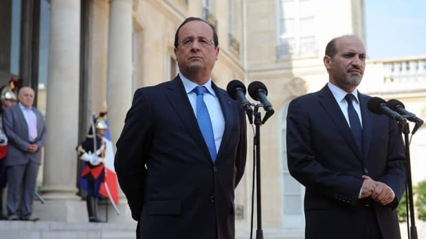 French President François Hollande, left, speaks to the media last week following a meeting with Ahmad Al-Assi Al-Jarba, leader of the opposition Syrian National Coalition. Hollande has condemned Syria's alleged use of chemical weapons and has said he is 'ready to punish' those responsible.