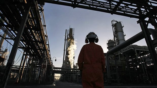 A worker at a Melbourne oil refinery is shown. If Linc Energy's find proves economical, Australia could soon be catapulted into the ranks of world energy superpowers
