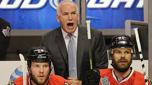 Chicago coach Joel Quenneville, seen during Game 1 of the Stanley Cup final, shares a couple of previous hockey destinations in common with Boston counterpart Claude Julien.