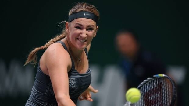 Victoria Azarenka of Belarus returns a shot to Li Na of China during their match on the fourth day of the WTA Tennis Championships in Istanbul, Turkey, Friday, Oct. 26, 2012.