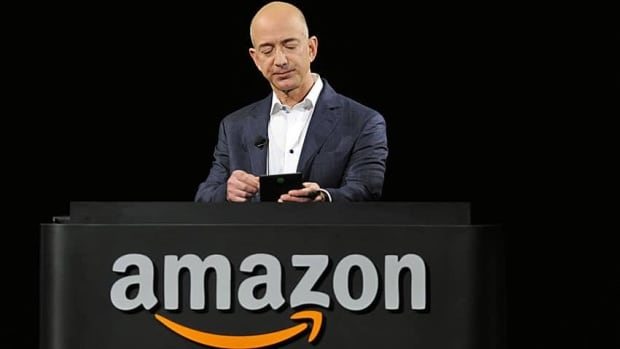 Amazon chief executive Jeff Bezos demonstrates the Kindle Paperwhite in September. His company is reported to be interested in expanding into Brazil with an acquisition there.