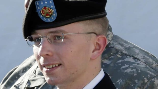 U.S. army Pte. 1st Class Bradley Manning is escorted out of a courthouse in Fort Meade, Md., after a pretrial hearing.