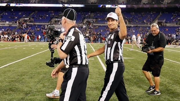 NFL officials Bob Waggoner, left and Gene Steratore take the field with the rest of the game crew for the first time this season before the start of the Baltimore Ravens and Cleveland Browns game on Thursday night.