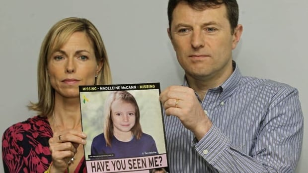 Kate and Gerry McCann hold up an age progression computer-generated image of their daughter Madeleine, who vanished in Portugal in 2007. British police have identified 38 'persons of interest' in a new investigation and say they continue to believe Madeleine is still alive.