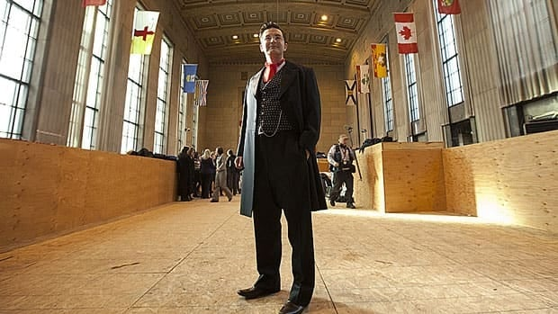 Conservative MP Pierre Poilievre poses for photographers after announcing the former Bank of Montreal building in Ottawa will be renamed the Sir John A. Macdonald Building in honour of Canada's first prime minister Wednesday.