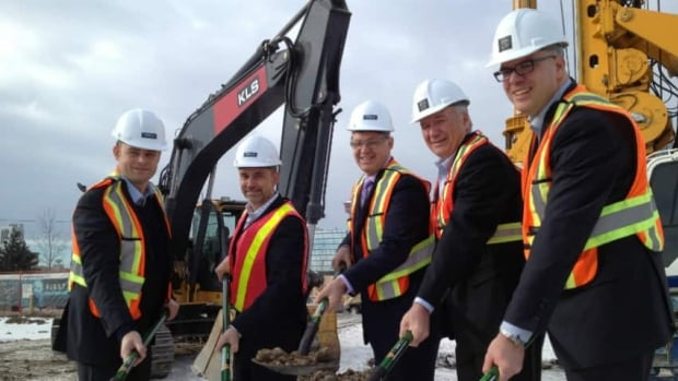 City officials break ground on the East Village's first condo complex in 2013.