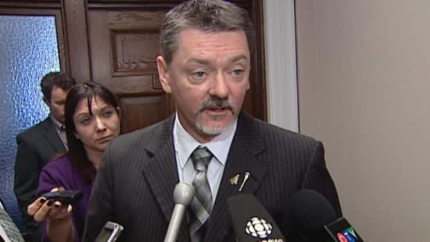 Alberta Finance Minister Doug Horner explains to reporters Wednesday why the province's economic forecast for 2013 is so gloomy.